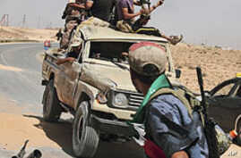 Pro-Gadhafi Forces Shell Misrata as Rebels Try to Advance