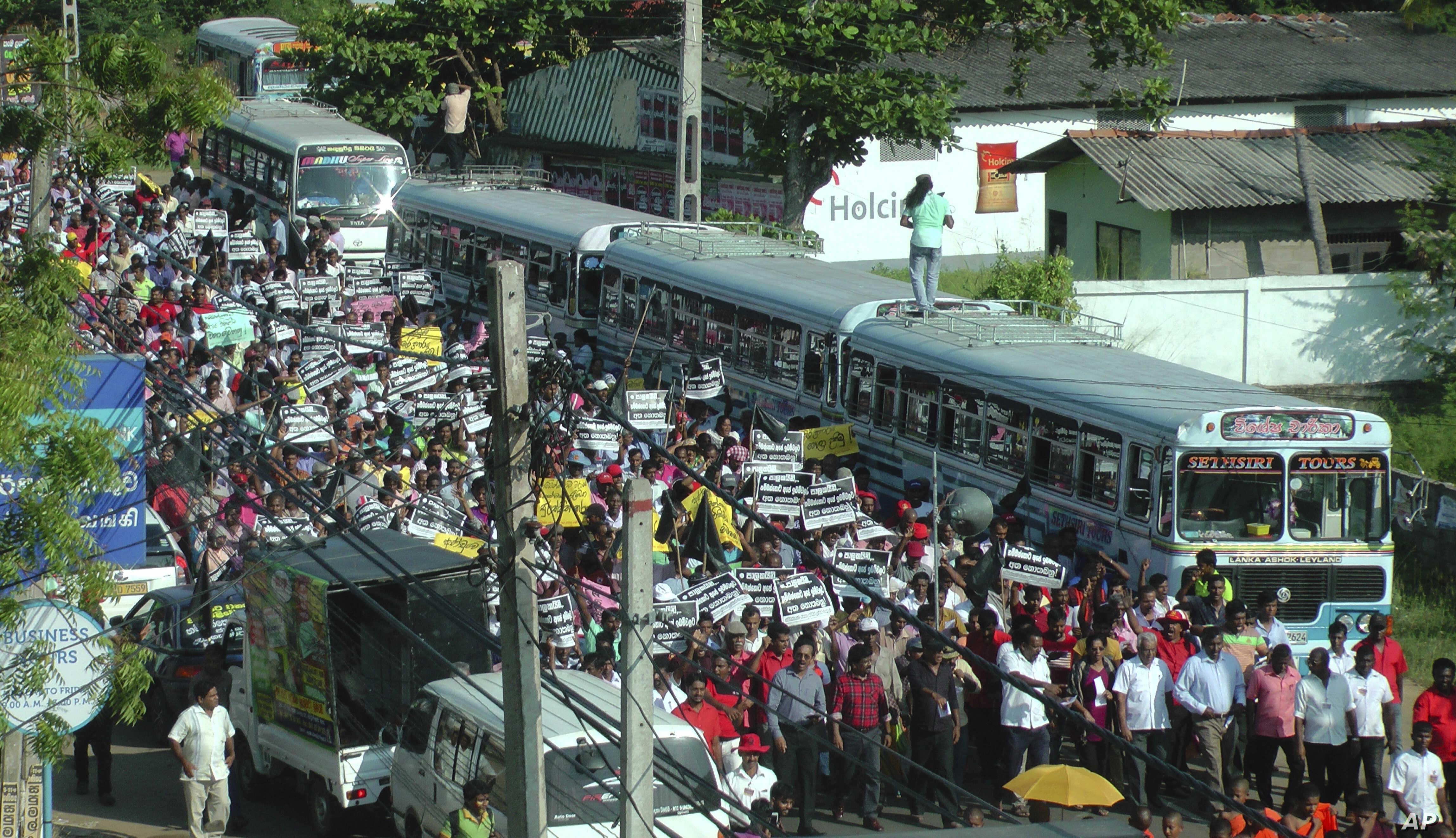 Sri Lankans lead by Marxist party People's Liberation Front march in a protest in Hambantota, about 230 kilometers south east of Colombo, Sri Lanka, Jan. 5, 2017. Hundreds of opposition supporters and farmers Thursday protested the Sri Lankan govern