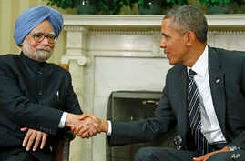 President Barack Obama shakes hands with India's Prime Minister Manmohan Singh in the Oval Office of the White House, Sept. 27, 2013.