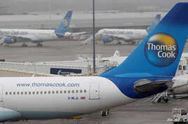 FILE: Thomas Cook aircraft are seen parked on the tarmac at Manchester airport in Manchester, Britain, November 22, 2011.