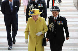 FILE - Britain's Queen Elizabeth walks with Metropolitan Police Commissioner Cressida Dick as she arrives at the new headquarters of the Metropolitan Police, in central London, Britain, July 13, 2017.