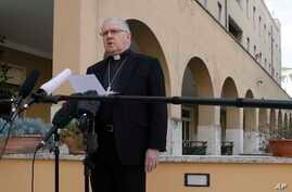 Brisbane's Archbishop Mark Coleridge reads a statement to the media on the conviction of Australian Cardinal George Pell for molesting two choir boys in the 1970s, in Rome, Feb. 26, 2019.