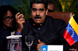 Venezuela's President Nicolas Maduro speaks at the IV Gas Exporting Countries Forum in Santa Cruz, Bolivia, Nov. 24, 2017.