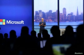 "FILE - Microsoft CEO Satya Nadella speaks during his keynote address at the company's ""build"" conference in San Francisco, California."