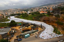 FILE -- Garbage bags line a street in Jdeideh, east Beirut, Lebanon, March 3, 2016. The Lebanese government announced on a temporary solution for the country's eight-month trash crisis, saying three landfills would be opened.