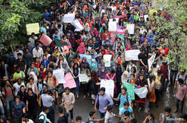 Thousands of students join in a protest over recent traffic accidents that killed a boy and a girl, in Dhaka, Bangladesh, Aug. 5, 2018.