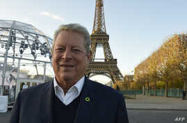 Former US vice president, politician, environmentalist and Nobel Peace Prize winner Al Gore is pictured within an interview with AFP on November 13, 2015 at the foot of the Eiffel Tower in Paris, ahead of the key United nations conference on climate