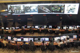 FILE - Indian Space Research Organization (ISRO) scientists and engineers monitor the movements of India's Mars orbiter at their Spacecraft Control Center in the southern Indian city of Bangalore, November 27, 2013.