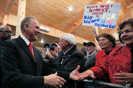 U.S. Senate candidate Roy Moore greets supporters before speaking at a campaign rally,  Dec. 11, 2017, in Midland City, Ala.