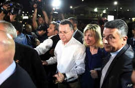 Pastor Andrew Brunson, center left, and his wife Norine Brunson arrive at Adnan Menderes airport for a flight to Germany after his release following his trial in Izmir, Turkey, Oct. 12, 2018,