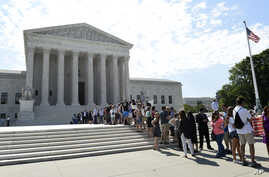 FILE - People wait in line to go into the Supreme Court in Washington.
