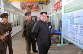 North Korean leader Kim Jong Un smiles during a visit to the Chemical Material Institute of the Academy of Defense Science in this undated photo released by North Korea's Korean Central News Agency in Pyongyang on Aug. 23, 2017.