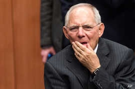 Germany's Finance Minister Wolfgang Schauble arrives for the Eurogroup finance ministers meeting at the EU Council building in Brussels, Feb. 11, 2016.