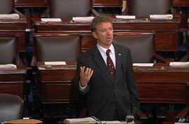 In this image from Senate video, Sen. Rand Paul, R-Ky., and a Republican presidential contender, speaks on the floor of the U.S. Senate Wednesday afternoon, May 20, 2015, at the Capitol in Washington, during a long speech opposing renewal of the Patr
