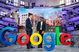 Google CEO Sundar Pichai and Philipp Justus, Google Vice President for Central Europe and German-speaking Countries, stand near a Google logo during the opening of a new Google office in Berlin, Germany, Jan. 22, 2019.