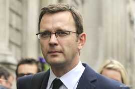 Andy Coulson, former editor of the News of the World and Former spokesman for Britian's Prime Minister David Cameron, leaves after giving evidence before the Leveson Inquiry into the ethics and practices of the media at the High Court in central Lond
