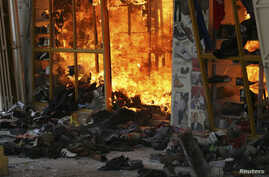A fire burns in a clothing stall after an explosion in a shopping complex in Kenya's capital Nairobi, May 28, 2012.
