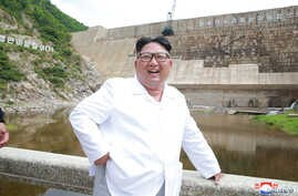 North Korean leader Kim Jong Un smiles during his visit to the under-construction Orangchon Power Station in this undated photo released by North Korea's Korean Central News Agency in Pyongyang, July 17, 2018.