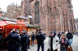 French police officers patrol outside the cathedral as the Christmas market reopens in Strasbourg, eastern France, Dec.14, 2018.