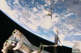 FILE - A Cygnus commercial resupply craft makes its final approach before docking at the International Space Station, as seen in this NASA image from video taken Jan. 12, 2014.