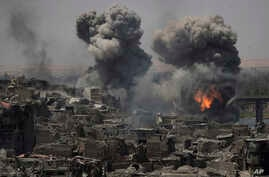 "Airstrikes target Islamic State positions on the edge of the Old City a day after Iraq's prime minister declared ""total victory"" in Mosul, July 11, 2017."