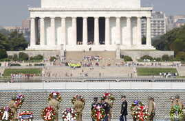 FILE - Soldiers dressed in WWII uniforms place wreaths in front of the Freedom Wall, with the Lincoln Memorial in the background, at the World War II Memorial during a ceremony to commemorate the 70th anniversary of VE (Victory in Europe) Day in Wash