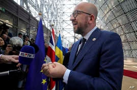 Belgian Prime Minister Charles Michel speaks with the media as he arrives for an EU summit in Brussels on Saturday, April 29, 2017.