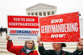 FILE - Activists from the state of Virginia rally against gerrymandering, in front of the U.S. Supreme Court, in Washington, March 28, 2018.