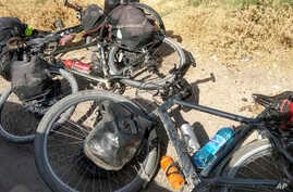 FILE - Bicycles are left where four tourists were killed when a car rammed into a group of foreigners on bicycles, south of the capital of Dushanbe, Tajikistan, July 29, 2018.