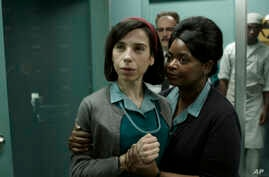 "FILE - This image released by Fox Searchlight Pictures shows Sally Hawkins, left, and Octavia Spencer in a scene from ""The Shape of Water."" The movie premieres at the Toronto International Film Festival."