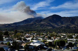 A wildfire known as the Thomas fire continues to burn in the hills outside Fillmore, Calif., Dec. 8, 2017.