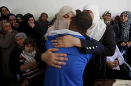 Relatives of Palestinian Abdullah al-Shalalda, who was killed by Israeli undercover forces in a raid at Al-Ahly hospital, mourn at his funeral in the West Bank village of Sair, north of Hebron, Nov. 12, 2015.