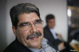 Saleh Muslim, head of the Kurdish Democratic Union Party (PYD), looks on during a Reuters interview in Berlin April 18, 2013.  Bombings of Kurdish areas in Syria suggest that Syrian Kurds, long detached from the revolt against President Bashar al-Ass