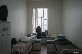 FILE - A patient is seen in a ward at the state-run Lavra clinic, Ukraine's main HIV treatment centre, in Kiev, Sept. 12, 2013.