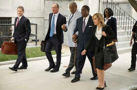 Bill Cosby, center, departs after a pretrial hearing in his sexual assault case at the Montgomery County Courthouse in Norristown, Pa., Sept. 6, 2016.