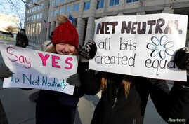 Net neutrality advocates rally in front of the Federal Communications Commission (FCC) ahead of Thursday's expected FCC vote repealing so-called net neutrality rules in Washington, Dec. 13, 2017.