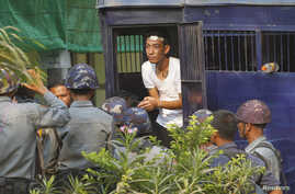 A student protester exits a prison vehicle, as he is sent to a court in Letpadan March 11, 2015. Myanmar's opposition National League for Democracy (NLD) demanded an inquiry on Wednesday into clashes between police and protesters in which students, m...