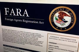 A portion of the website dealing with the Foreign Agents Registration Act is photographed in Washington, Aug. 18, 2016.