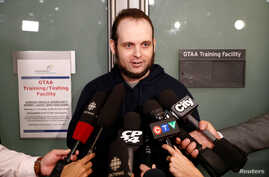 Joshua Boyle speaks to reporters after arriving with his wife and three children at Toronto Pearson International Airport, nearly five years after he and his wife were abducted in Afghanistan in 2012 by the Taliban-allied Haqqani network, in Toronto,