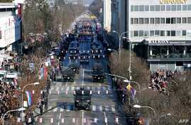 "Bosnian Serb police officers take part in a parade marking the  ""Day of Republic Srpska"" in Banja Luka, Jan. 9, 2019, defying a 2016 legal ban."