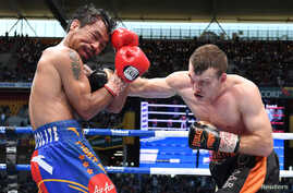 Jeff Horn of Australia punches Manny Pacquiao of the Philippines during the WBO welterweight world title match July 2, 2017 in Brisbane, Australia.