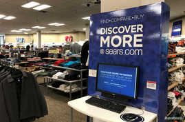 FILE - An online shopping kiosk is shown inside a Sears department store in La Jolla, California, March 22, 2017.