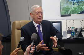 US Defense Secretary Jim Mattis aboard his official aircraft on the first leg of a trip which will take him to China, South Korea and Japan, June 24, 2018