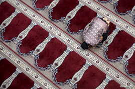 A man prays following Friday prayers at the Cut Meutia Mosque in Jakarta, Indonesia, Feb. 12, 2016.