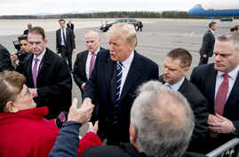 President Donald Trump greets guests on the tarmac as he arrives at Greenbrier Vally Airport, in Lewisburg, W.Va.,  Feb. 1, 2018, to speak at the 2018 House and Senate Republican Member Conference at The Greenbrier.