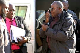 Zimbabwean opposition official Tendai Biti arrives at the magistrates courts in Harare, Thursday Aug. 9, 2018. Biti was deported to Zimbabwe following his arrest in Zambia after his asylum bid was rejected.