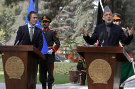 Afghanistan's President Hamid Karzai (R) speaks as NATO Secretary General Anders Fogh Rasmussen looks on during a joint news conference in Kabul, October 18, 2012.