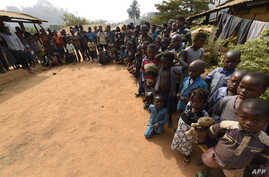 FILE - Cameroonians, including women and children, refugees from the country's restive anglophone regions, gather for a meeting at Bashu-Okpambe village, in Boki district of Cross Rivers State in Nigeria, Jan. 31, 2018.