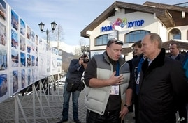Russian President Putin, left, with Interros Investment President Vladimir Potanin, Rosa Khutor Alpine Center, near Sochi, Feb. 6, 2013.
