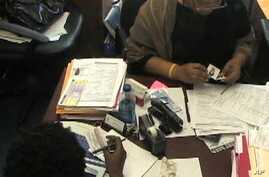 A Haitian woman applies for temporary protected status (TPS)